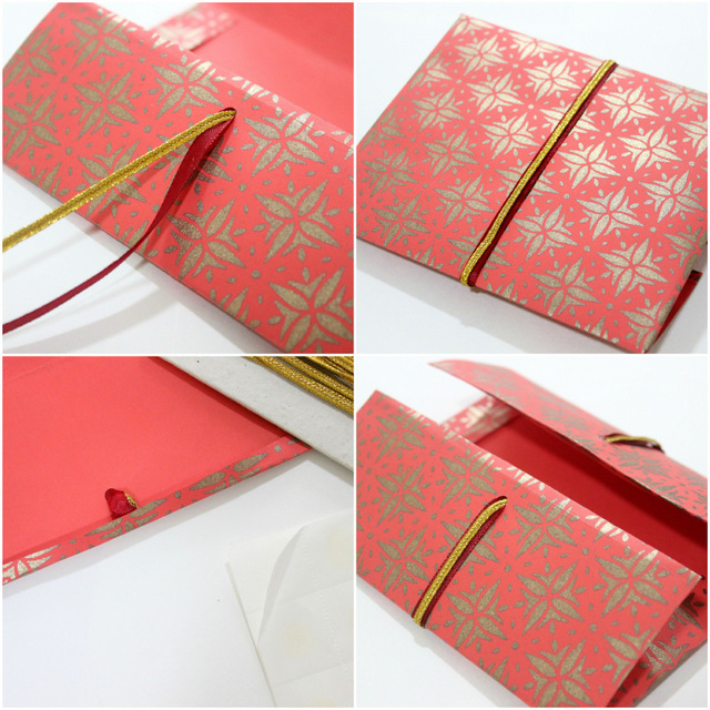 red envelope with ribbon