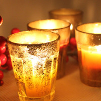 How to DIY Chai Glass Candles for Diwali. Decorate with gold and bright colours!