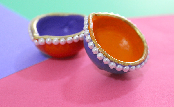 diyas decorated with pearls