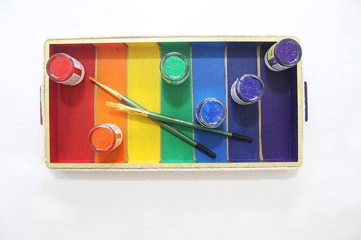 rainbow tray with paint bottles