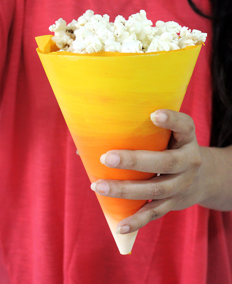 yellow paper cone with popcorn