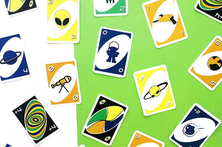 Card playing game UNO for children party, space themed